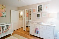 Pink and Gold Nursery with fab gallery wall above changing table