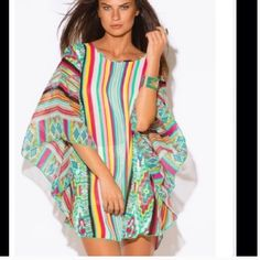 """Plus Size Beach Cover Up This colorful top is perfect for your next tropical getaway. Wear it as a beach cover up over your suit, or as a tunic with a tank and leggings. Poncho style with hidden sleeve opening that measures 11"""" wide. 2XL measures 34"""" from top of shoulder to bottom. 3XL measures 35"""" from top of shoulder to bottom. Printed chiffon in gorgeous colors. Unlined. Semi sheer. 100% polyester. Made in the USA. Made in USA Swim Coverups"""