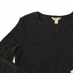 "NWT Laura Ashley Black Sparkle Tunic NWT Super fun tunic!! Is black and is covered in silver dots!! Outside of shirt is 93% nylon, 4% spandex, 3% other fiber... Inside of shirt is 100% nylon. Shoulder to hem 30"" long, pit to pit 18 1/2"". 3/4 length sleeves and the material is pretty stretchy! Retail $68! NO TRADES. Laura Ashley Tops Tunics"