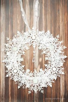 Creations by Sue Dollar Store Snowflake Wreath. Create a beautiful DIY snowflake wreath to display all winter long using supplies from Dollar Tree in less than 15 minutes. Dollar Tree Christmas, Dollar Tree Crafts, Christmas Crafts, Christmas Decorations, Diy Snowflake Decorations, Snowflake Wreath, Christmas Snowflakes, Christmas Ornaments, Christmas Swags