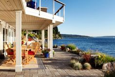 The outdoor room decorating experts at HGTV.com share photos of a gorgeous waterfront home that features designated areas for outdoor dining, gathering with friends and lounging by a firepit.