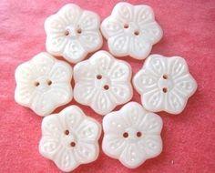 7 Vintage glass buttons, six petal flower shape, white milk, 16.5mm, proper for button jewelry. $3.00, via Etsy.