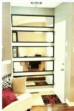 cheap mirrors that usually hang behind doors, when hung horizontally, turns chic
