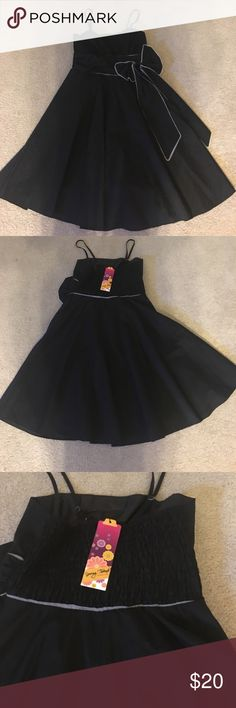 Little black dress Spaghetti strap, above the knee, black swing dress. Gathered midsection with a bow on the left hip. Dresses Midi
