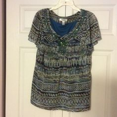 Top Sequined short sleeve top. Looks nice with navy or black pants. Great for office casual. Dress Barn Tops