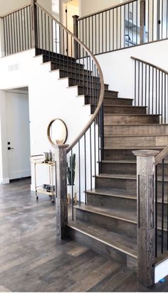 Beautiful Curved Staircase With A Metal Baluster System.