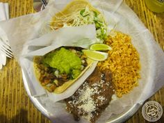 image of pollo assado (charbroiled chicken) and pescado (fish) tacos at Pinche Taqueria in NYC, New York