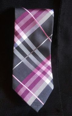 """This is a pre-owned tie measures 57"""" long and 3"""" wide. Has some wrinkles and pulls from usage. 
