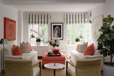Grey and white living room with pops of coral