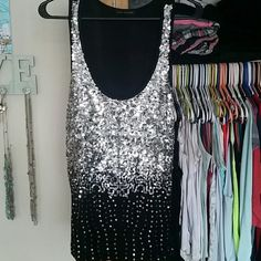 Beautiful black top with silver sequins So fun!!! Super cute with tons and tons of sequins. Great condition. Worn once. Tops Tank Tops