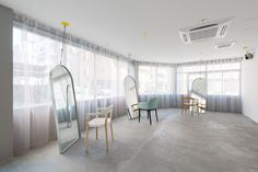 mirrors hang from cables in Japanese hair salon done by sides core
