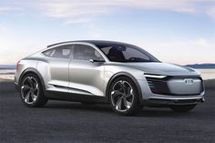 The Audi e-tron Sportback, a battery-electric SUV with a low-slung, coupe-like roofline, shown parked near a lake. Shanghai, Lamborghini, Los Cars, Cars Uk, Mercedes Benz, Volkswagen, Eco Friendly Cars, Jeeps, Modified Cars
