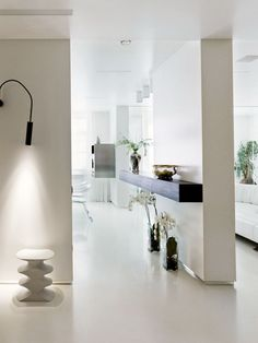 Apartment: Simple Apartment Decoration With White Wall Color And Wall Lamp Also Vase And Downlight And Walll Table: Pure Simple Apartment Decorating Ideas