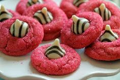 Pink Peanut Butter Kiss Cookies- my sister made these cookies for my baby shower since the theme was zebra and the colors were hot pink, black, and white... Perfect, eh?! they were yummy just like regular PB blossoms. They are also perfect for Valentine's day! <3