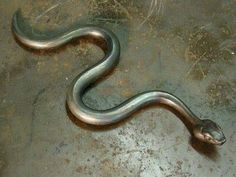 Ken Neiderer created this snake from forged steel. For some reason Cleopatra's asp comes to mind. Metal Art Projects, Welding Projects, Metal Crafts, Antler Crafts, Snake Art, Blacksmith Projects, Snake Design, Steel Sculpture, Small Sculptures