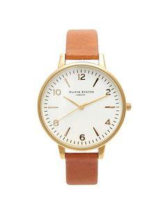 OLIVIA BURTON kello nahkarannekkeella jossa pyöreä kellotaulu ja kullan-roseenvärinen raami. Alapuolella merkin logo. Kellotaulu 38 mm. Säädettävä ranneke.