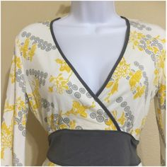 New York & Company Blouse Size XS New York & Company Women's Blouse Size XS White, Yellow, & Gray Colors Floral Pattern 3/4 Sleeve V Neck Wrap Front Look Banded Under Bust With Sash tie Flared Sleeves Side Slit Bottom Hem Machine Washable 95% Rayon 5% Spandex Armpit to Armpit Approx. 17 Inches Length From Rear Collar Approx. 26 Inches Shoulder Approx. 15 Inches Sleeve From Shoulder Seam Approx. 19 Inches Please Measure To Ensure A Proper Fit New With Tag New York & Company Tops Blouses
