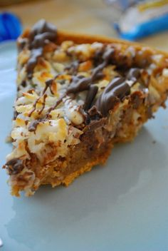 Almond Joy Magic Pie Recipe ~ Says: Almond Joys, coconut cream cookies, shredded coconut, coconut Hershey's Kisses, and poured on a healthy helping of sweetened condensed milk to bring it all into one gooey circumference of deliciousness. And then I drizzled it with chocolate for good measure
