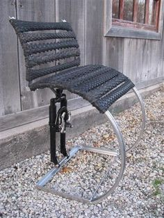 Single Chair made with tire treads and suspension fork....artist The Recycler