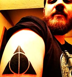 New tattoo. Inverted deathly hallows from Harry Potter.