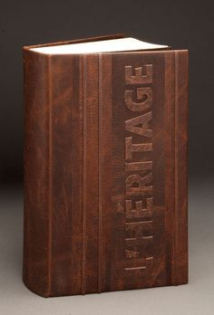 L'Héritage by Jonathan Tremblay, 2011. Full-leather binding, caribou coffee color. Decor done with mosaic inlay and mosaic raw-edge. Guard and flyleaf are encrusted suede, espresso color. Dimensions: 9.5 × 6 × 2 inches, 24.5 x 15 x 5.5 centimeters. Caribou leather