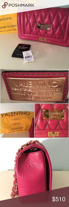 """🎊HP🎊Valentino by Mario Valentino Alice D Bag Quilted leather in diamond shape. Dark pink/magenta with green stitching. Dust bag. Gold metal hardware. Fold over flap with turn lock closure. Interior has 2 zip pockets and cell phone pocket. Lined in tan fabric. Chain and leather strap. Used a few times and in great condition. Metal on interior shows wear. Oxidizing/rusting. Mark on exterior lock. Mark on outside at bottom. Cell phone pocket is coming unsewn. Approximately 12"""" strap drop…"""