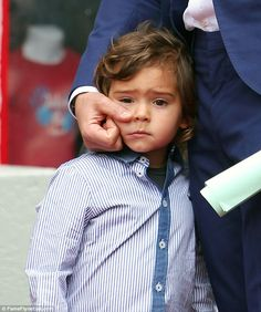 Can we go soon, Daddy? The star was joined at the ceremony by his family and co stars, including son Flynn