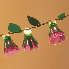 plastic bottle flower | fun flower lights from plastic bottles.. recycling & cute! Could put around the recycled bed frame trellis.