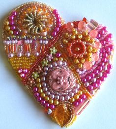 Google Image Result for http://2.bp.blogspot.com/-T6al3IA1TwM/To9Ty1NpBfI/AAAAAAAABik/pp5re2k92ZM/s1600/BEADED%252BHEART.jpg