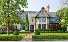 This 8,437-square-foot Tudor estate in Highland Park, Texas, is listed for $4.295 million.