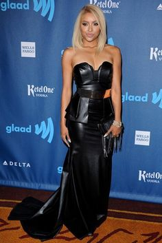 Kat Graham Leather Dress - Kat Graham showed off her sexy side with this strapless black leather dress that featured a peplum top and a flowing train.