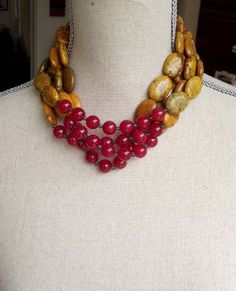 Chunky necklace in a fall color palette. Interesting combo... Wonder what the golden beads are, jasper?