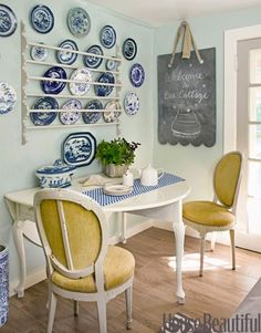 ♥♥♥ the simple plate rack and yellow upholstered chairs