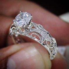 We absolutely love the scrollwork detail on this diamond engagement ring. Would you wear it?
