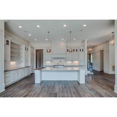 """wall/trim color are BM Classic grey & cabinets are BM linen----Chandelier Development on Instagram: """"One of our favorite kitchens...complimented by open living and unbelievable finishes! #chandelierdevelopment #custom #reclaimedwood #whitemarble #whitekitchen #calcuttagold #butcherblock #the_real_houses_of_ig #inspire_me_home_decor #interior123"""" --- wall/trim color are BM Classic grey & cabinets are BM linen"""