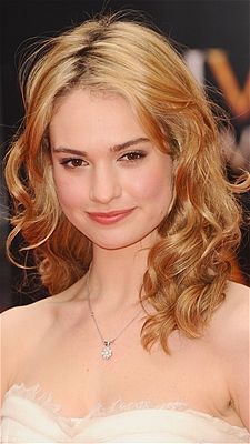 British actress Lily James wore shoulder-length lock in soft curls to the 2013 Laurence Olivier Awards at The Royal Opera House.