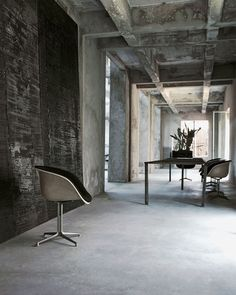 Photo via Vincenzo de Cotiis Architects via T Converted from a 1940s sock factory, this peak-industrial hideout in northern Italy was at one point the office of Italian designer and...
