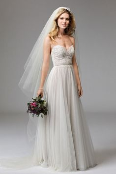 Della speaks to Wtoo's signature soft and flowy style. Thoughtfully-placed Cybele Lace on the bodice and a graceful, Soft Netting skirt are perfectly accented with a velvet ribbon belt.
