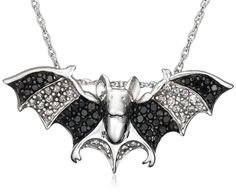 Sterling Silver Black and White Diamond Bat Pendant. Wow.