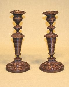 A well-cast Pair of early 19th Century French bronze Candlesticks having foliate sconces & moulded nozzles above ringed tapering stems supported on leaf & shell decorated circular bases. Circa: 1830 Ref: 4565