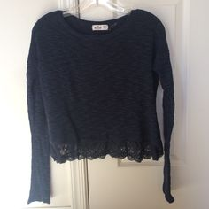 Hollister Sweater Cute navy blue Hollister sweater wth lace at the bottom. Size XS/S. Worn twice just doesn't fit anymore. In perfect condition! Accepting all offers! Hollister Sweaters Crew & Scoop Necks
