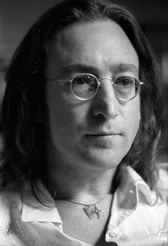 John Lennon dressed in a Western shirt and a cross necklace in his apartment at the Dakota, New York February 25, 1975 Photography By Brian Hamill