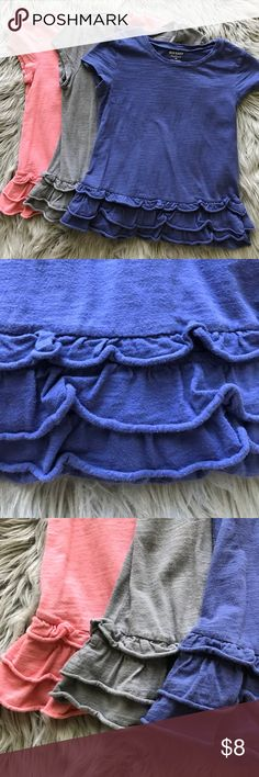 Bundle of 3 Old Navy short sleeve shirt Bundle of 3 Old Navy short sleeve shorts. Cute ruffles on the bottom, which does go around the back also. Colors: blue, grey, orange. All are size M (8) Old Navy Shirts & Tops
