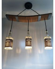 This light fixture is made from repurposed Jack Daniels bottles and wooden slats from a used barrel including the metal bands. Would be a - Diy Healthy Home Remedies