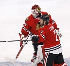 Chicago Blackhawks goalie Scott Darling (33) and Brent Seabrook celebrate Seabrook's game winning goal during the third overtime period in Game 4 of an NHL Western Conference hockey playoff series against the Nashville Predators Wednesday, April 22, 2015, in Chicago. The Blackhawks won 3-2. (AP Photo/Charles Rex Arbogast)