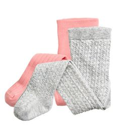 Light gray. Pattern-knit tights in a soft cotton blend with an elasticized waistband. One cable-knit pair and one rib-knit pair.