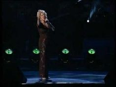 Bette Midler - From A Distance.  I would sing this to my kids when they were babies.. Thanks for pinning!  :)