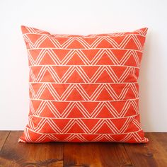 Geometric Poppy Pillow. Perfect for brightening up a bedroom or living room. #color #geometric #fun dotandbo.com