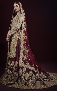 This bridal lehenga is featured in gold brocade shirt with zari hand embroidery all over it. Lehenga skirt is in maroon colour with heavily embroidered in zardo Pakistani Wedding Outfits, Pakistani Wedding Dresses, Bridal Outfits, Indian Dresses, Indian Outfits, Bridal Wedding Dresses, Bride Dresses, Wedding Suits, Bridesmaid Dresses
