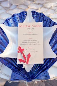 Nautical menu on sea shell chargers. All tablescape items are available at TJ Maxx, too.